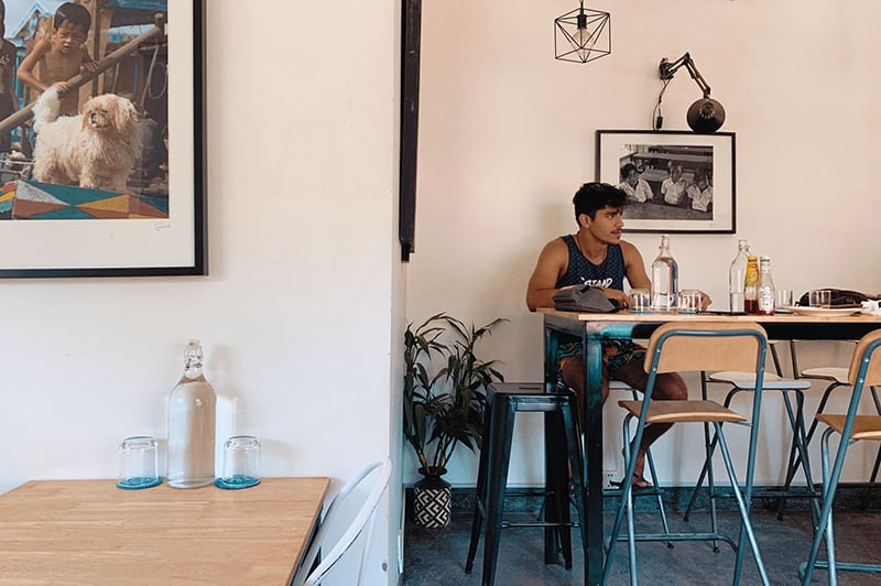 man sitting alone by the dining table