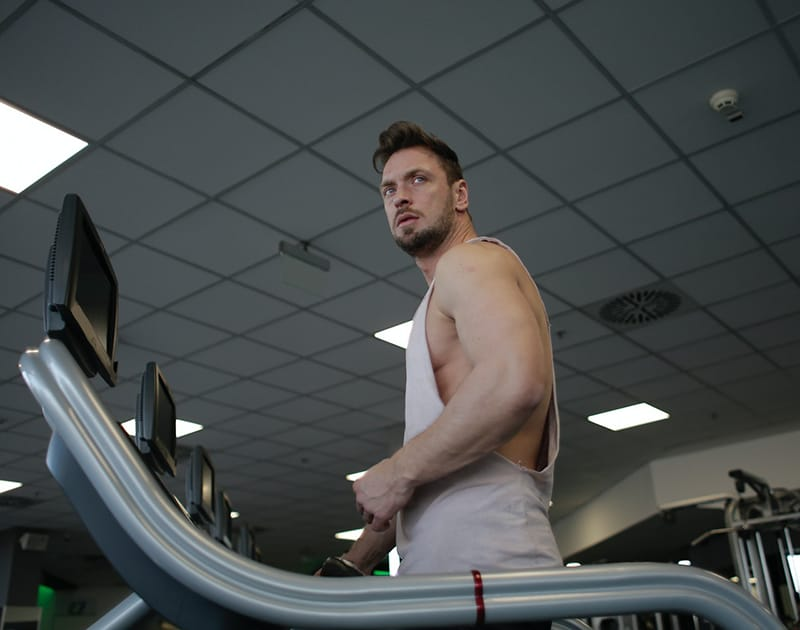 man using treadmill in the gym