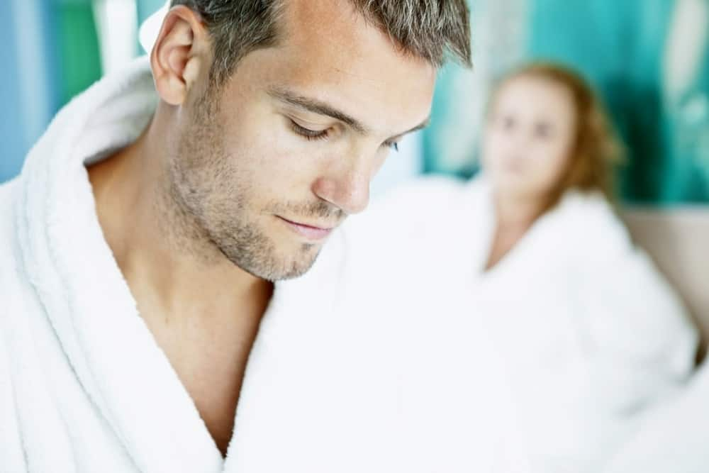 man with white robe beside woman in white robe