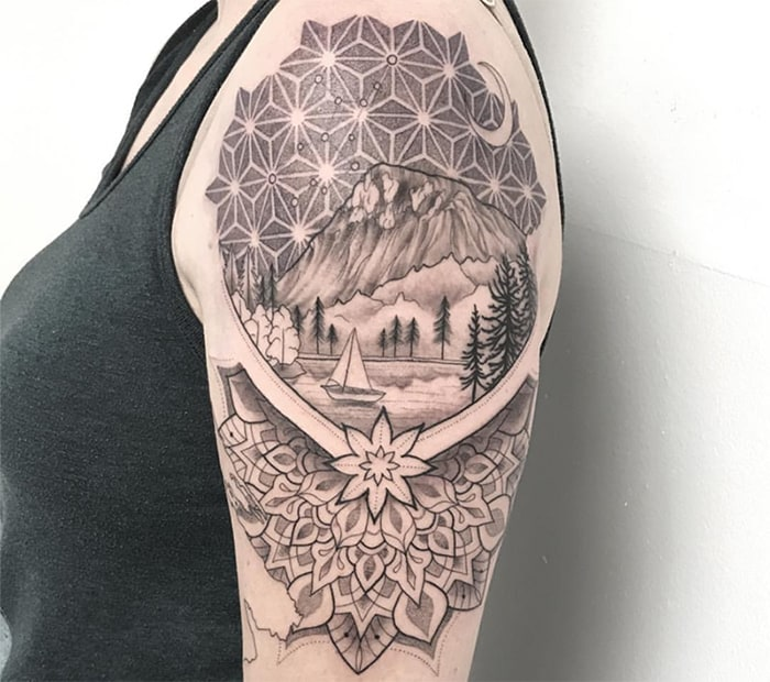 mandala inspired style tattoo with mountain and lake scenery under a constellation