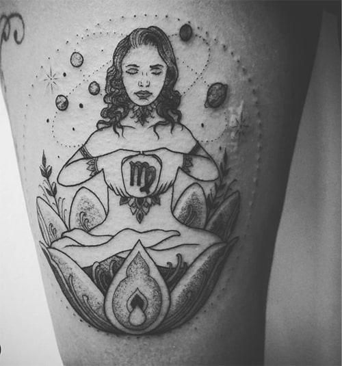 meditating woman inside of a lotus tattoo surrounded with planets
