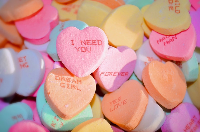 multicolor heart shaped candies with notes