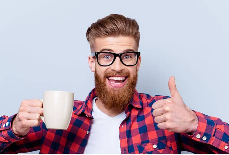 nerd man with cup in checkered top