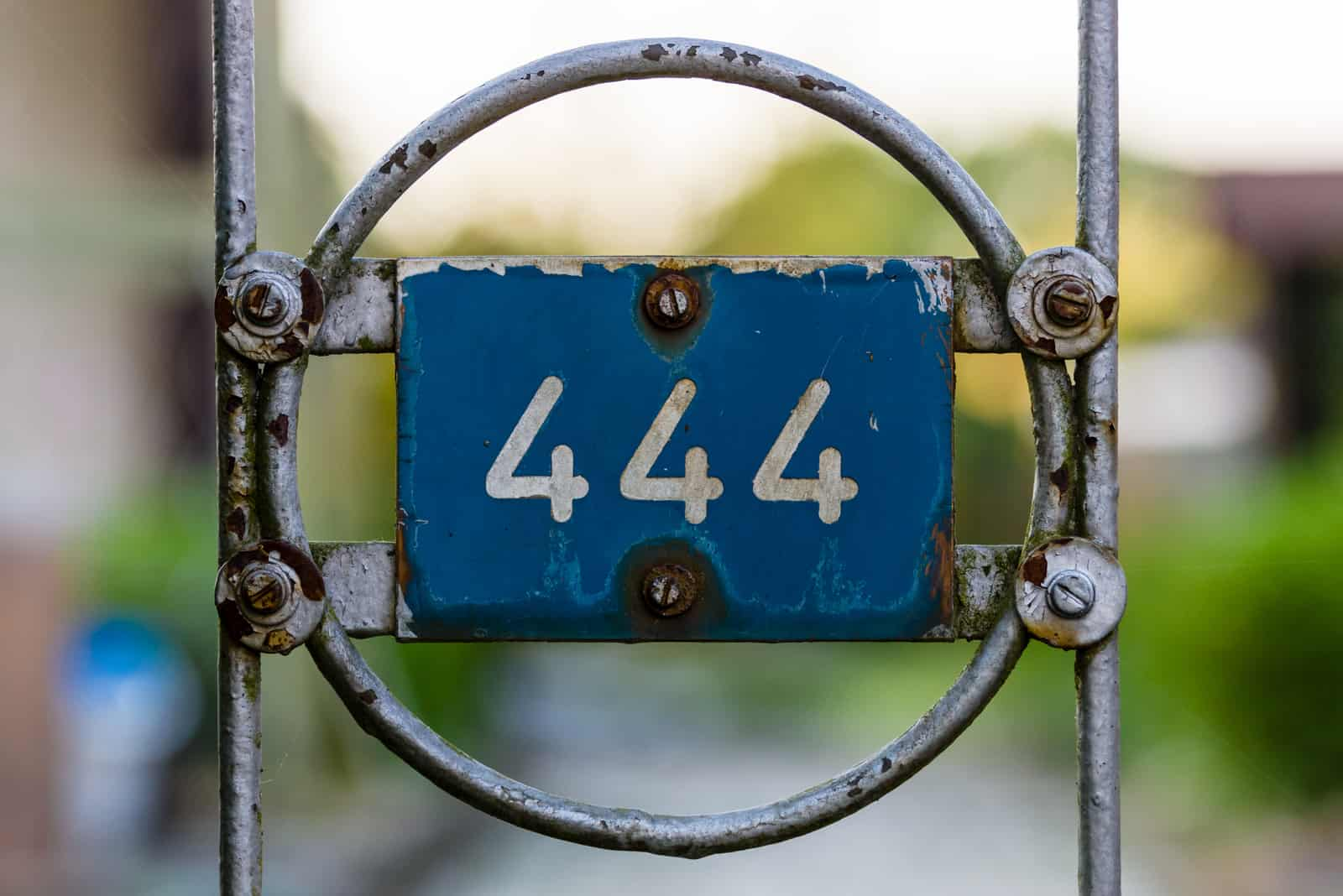 number 444 on a wrought iron fence