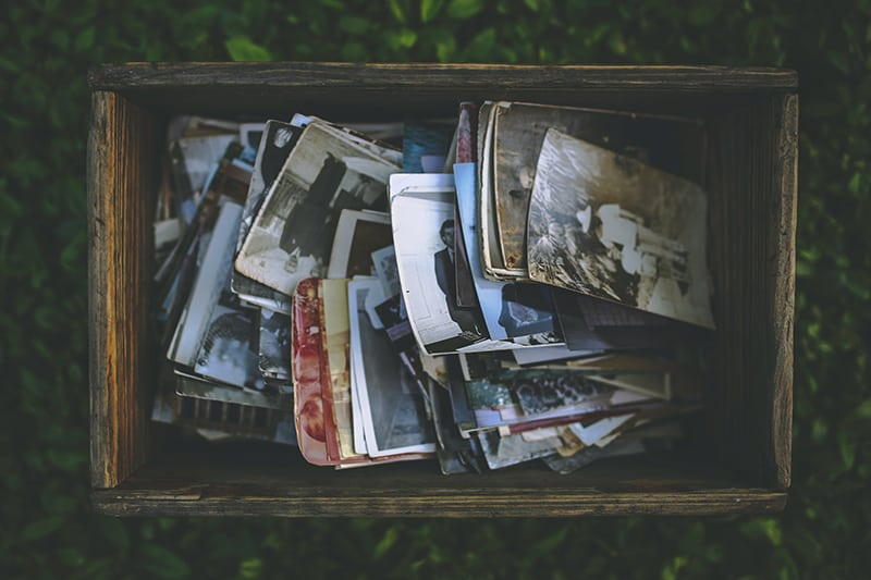 old photos in wooden box