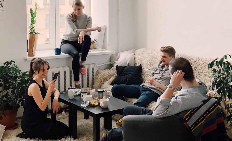 People gathered inside house sitting on sofa during daytime