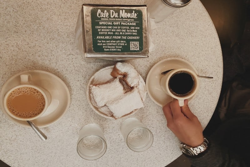 two cups of coffee near sliced cake