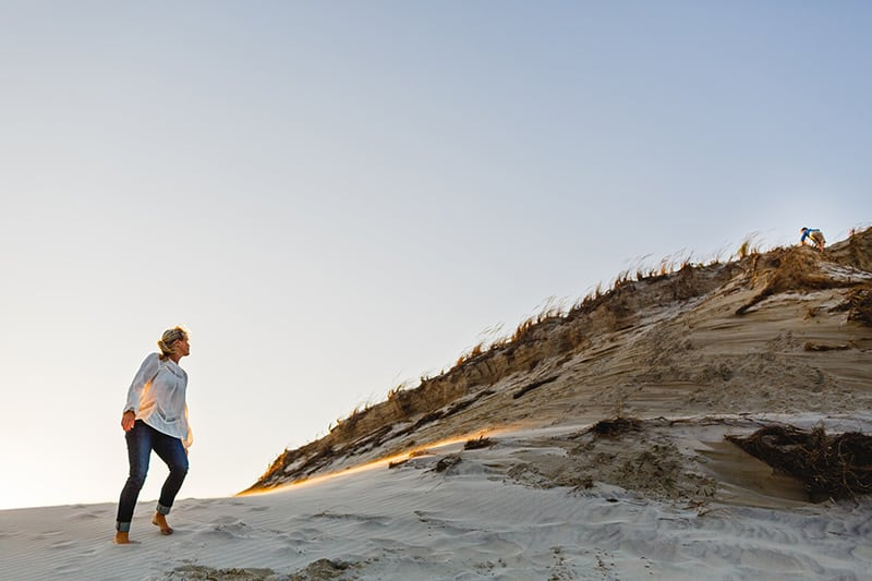 person standing on mountainside during daytime