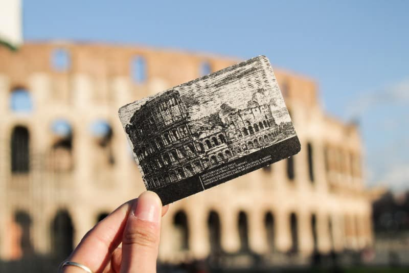 woman holding colosseum ticket