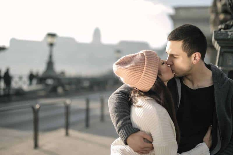 photo of a couple hugging and kissing