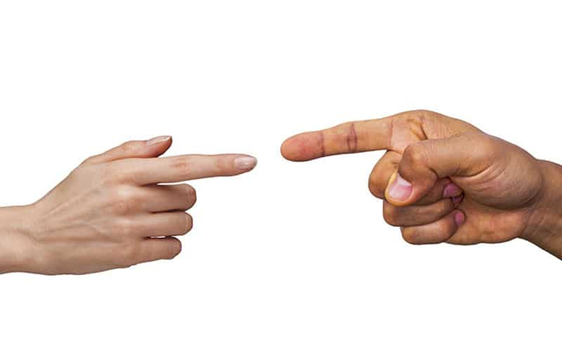 pointing fingers of a man and woman