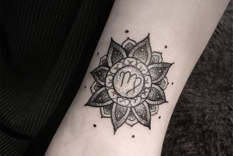 pretty mandala Virgo tattoo surrounded with small dots