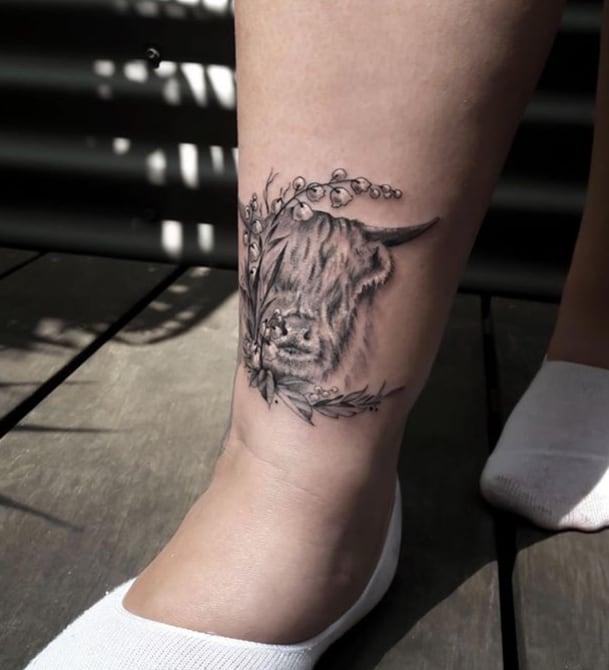 realistic taurus tattoo on the leg