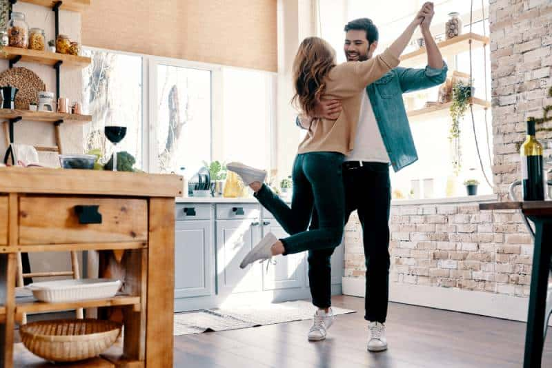 romantic couple dancing in the kitchen