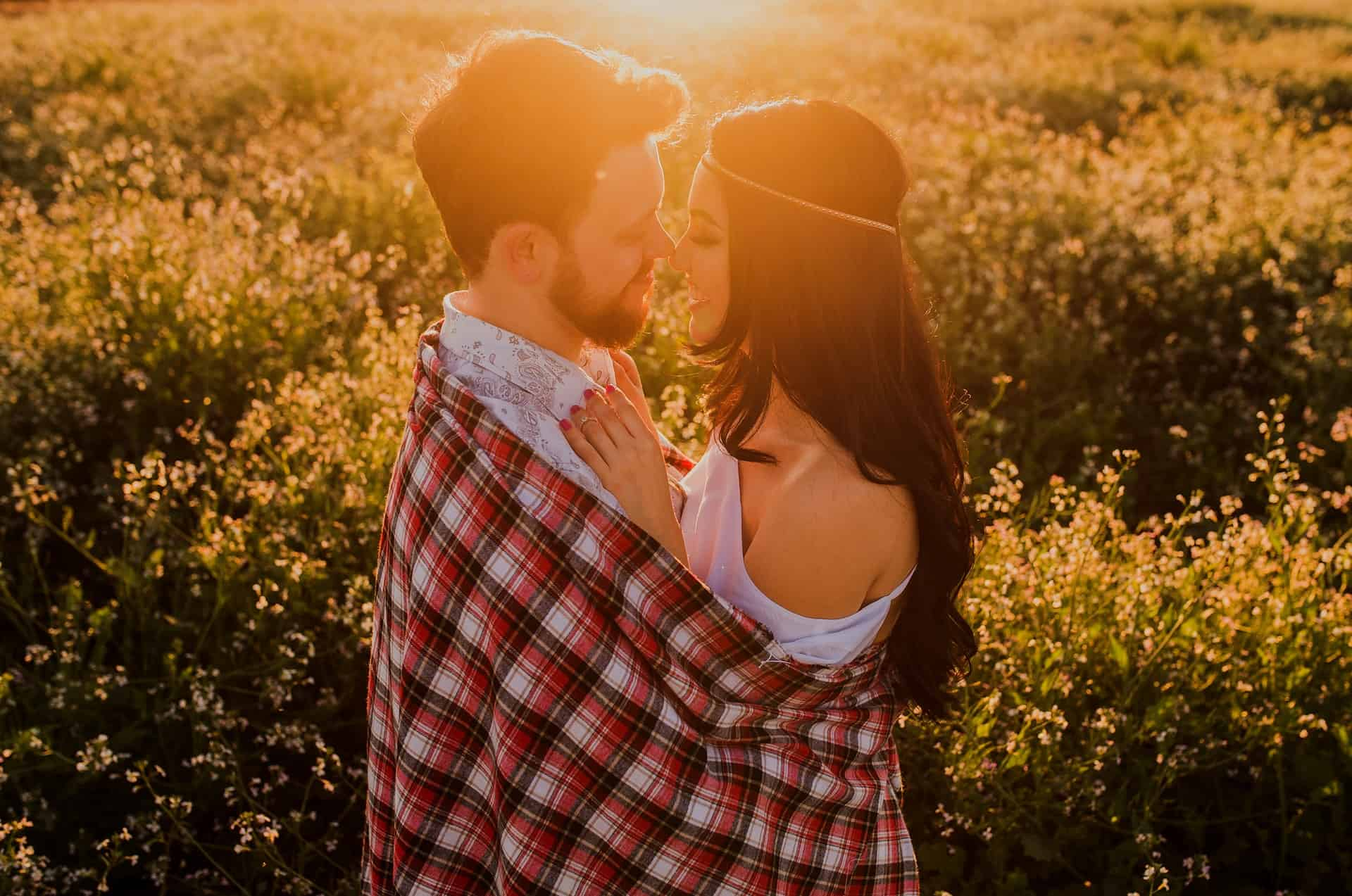 romantic couple hugging on sunset