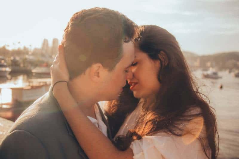 romantic couple kissing outside