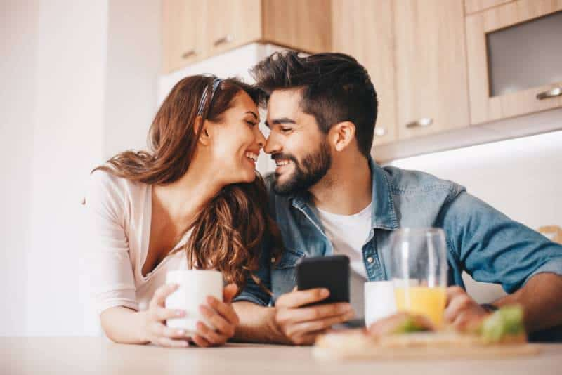 romantic couple sitting in the kitchen