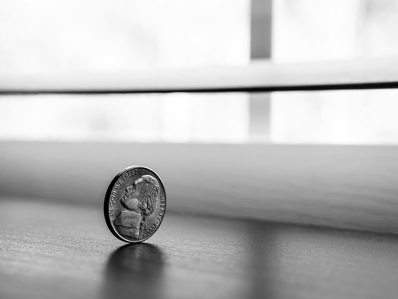round silver coin on the table