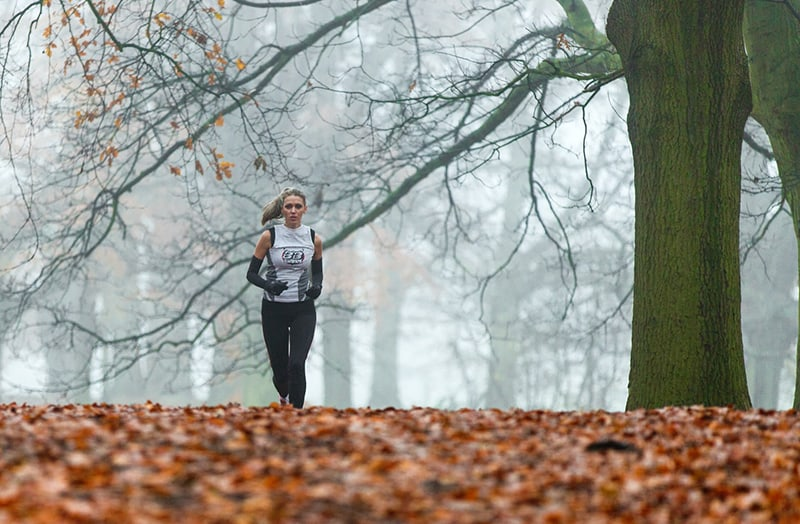 running woman under tree during daytime