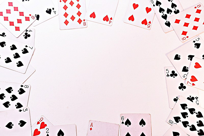 scattered playing cards in rectangle frame on white background