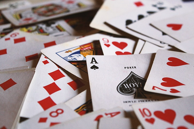 scattered playing cards on the table