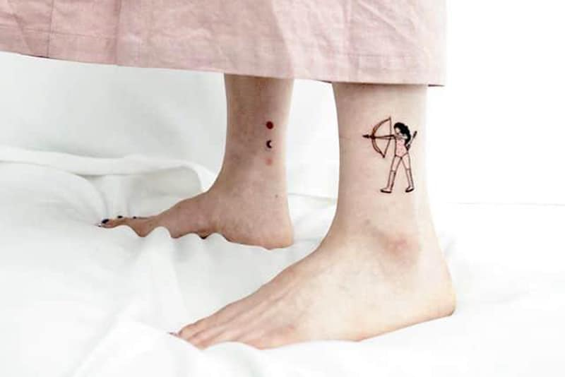 shooting for the stars tattoo with stagittarius on one ankle and stars on other ankle
