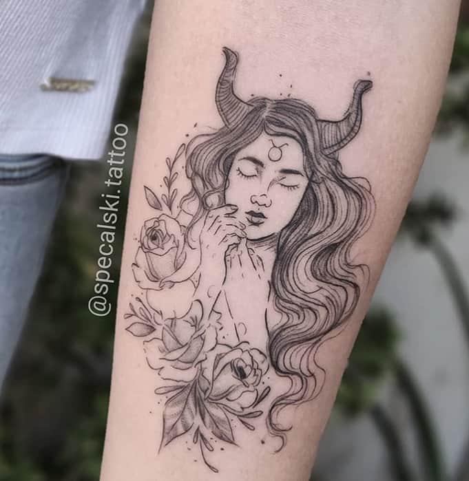 sleepy girl with bulls horns tattoo on the arm