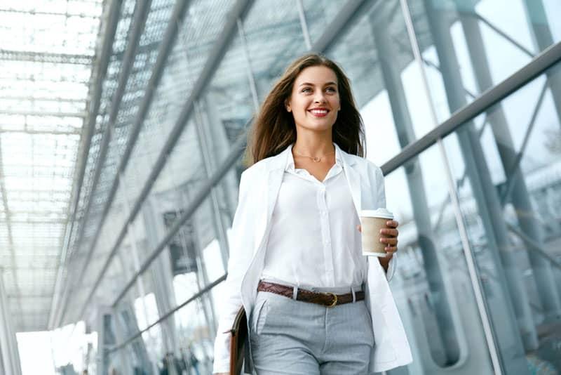 smiling business woman walking