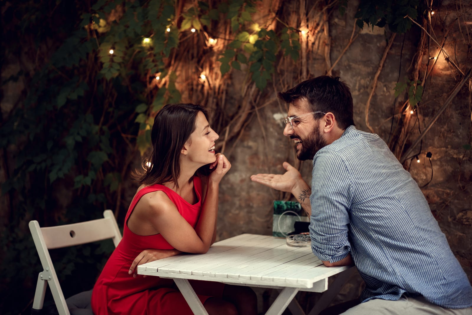 smiling couple flirting by the table