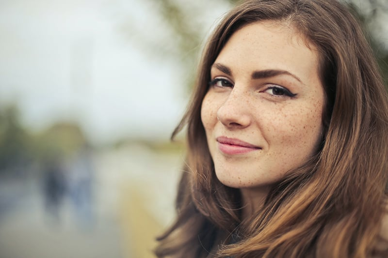 smiling woman with long brown hair