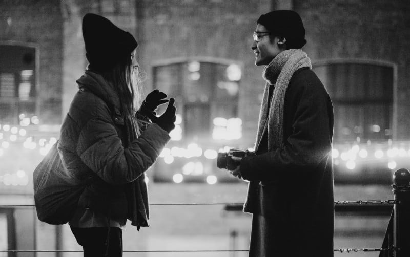 talking man and woman on the street in the evening