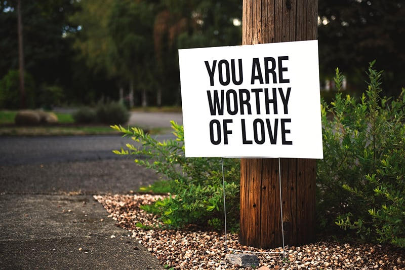 the board with a message you are worthy of love
