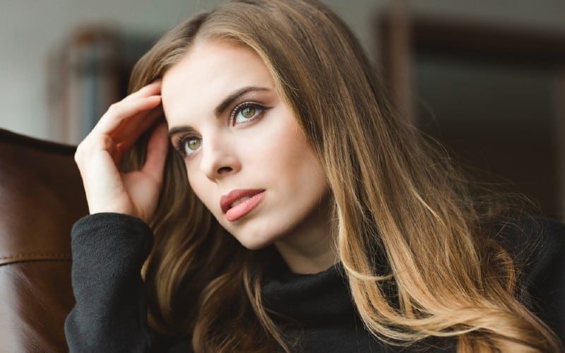 Thoughtful young woman portrait