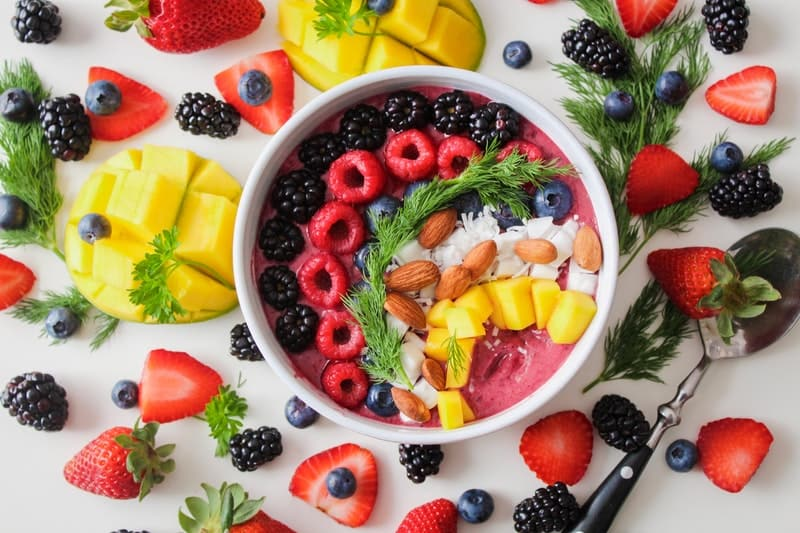 top view of smoothie with different berries and mangoes