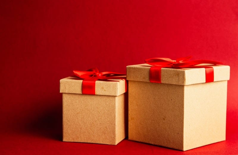 two brown and red gift boxes on red surface