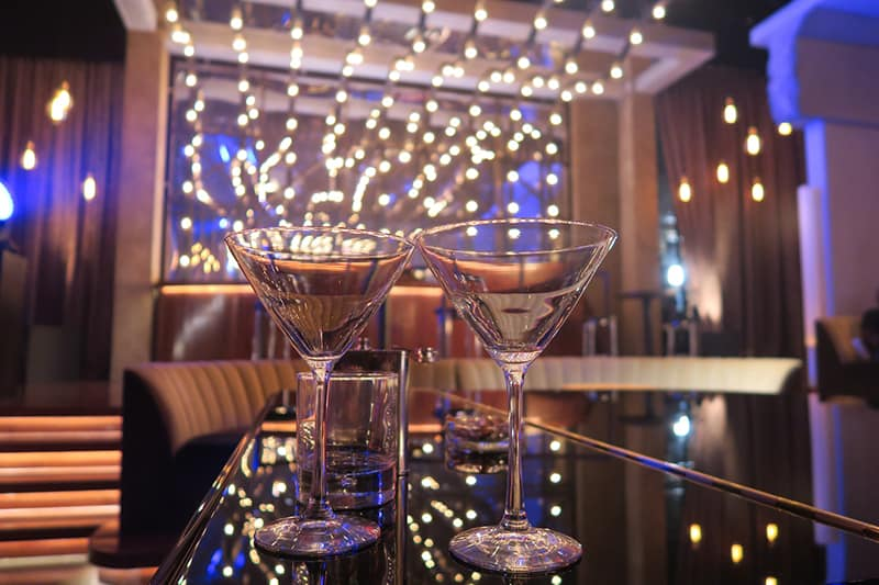 two martini glasses on the table in the club
