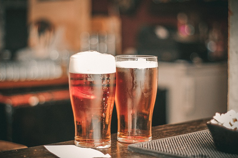 two pilsner glasses on the table