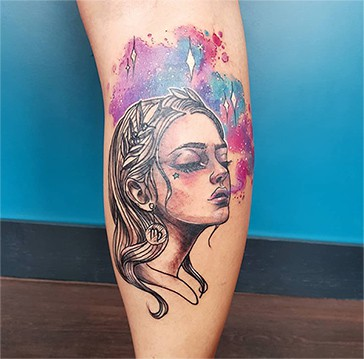 watercolor tattoo with a portrait of a woman wearing a Virgo earring