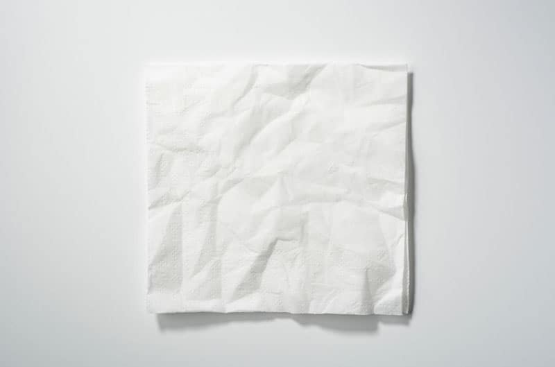 white crumpled paper smoothen placed on white background