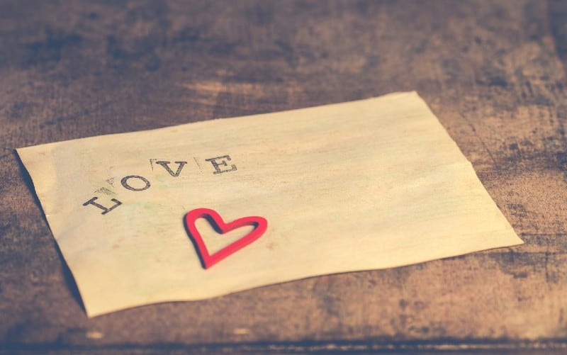Old white paper printed with love word and heart on it