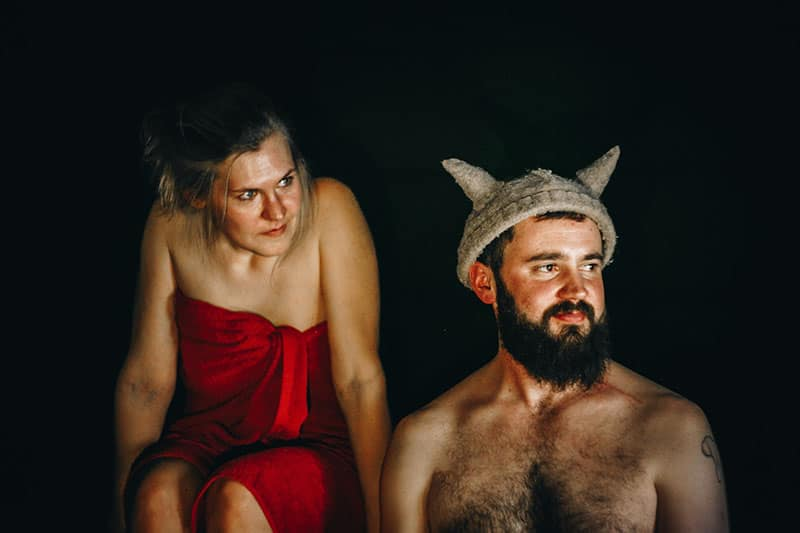woman angry at man with a viking cap
