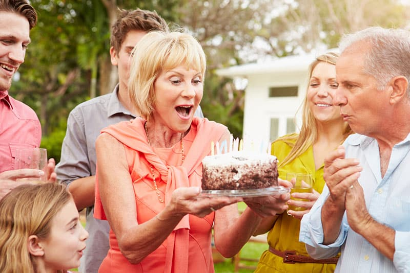 woman celebrating birthday with her family