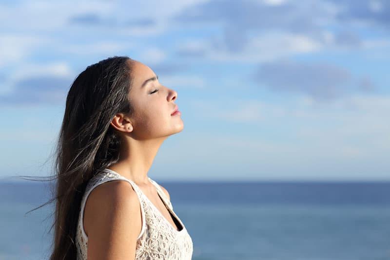 woman deepbreathing by the sea