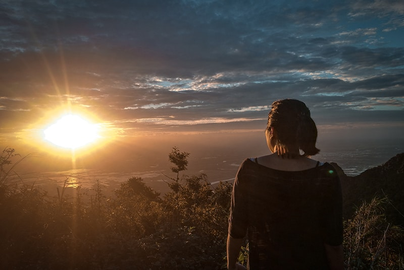 woman in black off shoulder top watching sunset