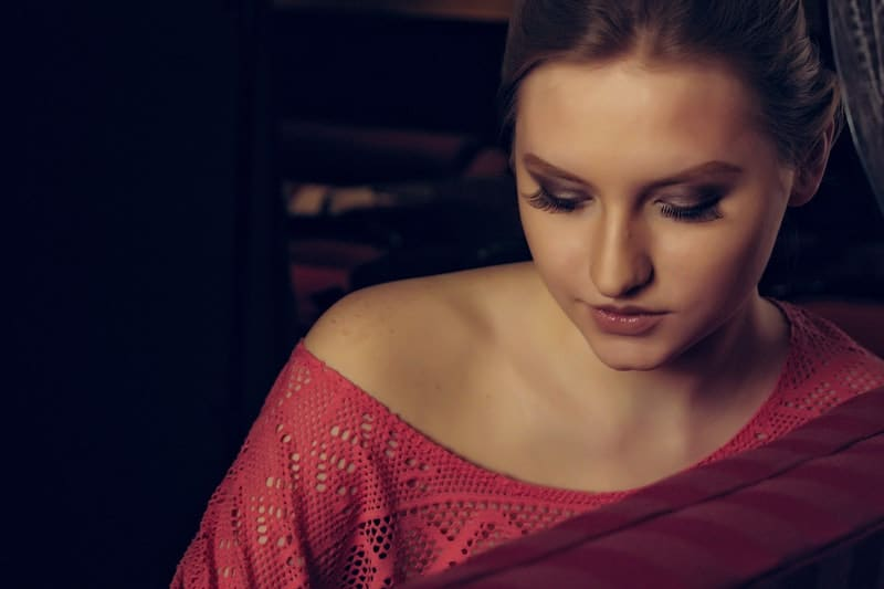 woman in red off shoulder top