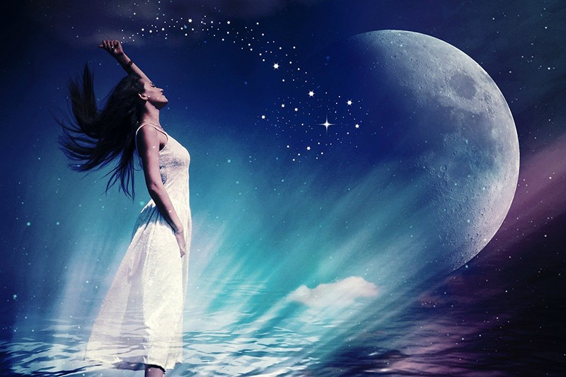 woman in white dress under the moon and the stars