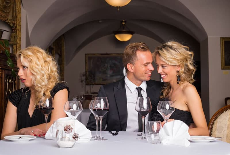 woman jealous over two lovers sharing the same table with