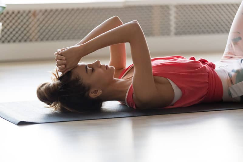 woman laying on the fitness floor
