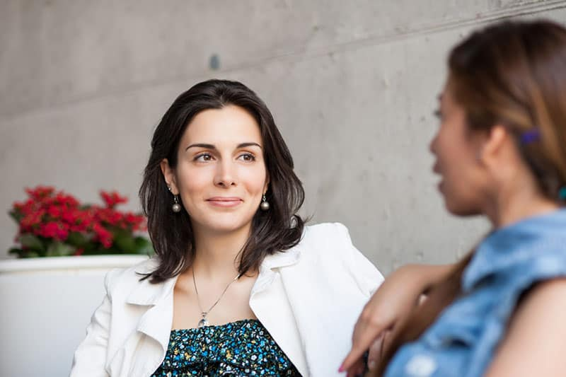 woman listening her friend talking