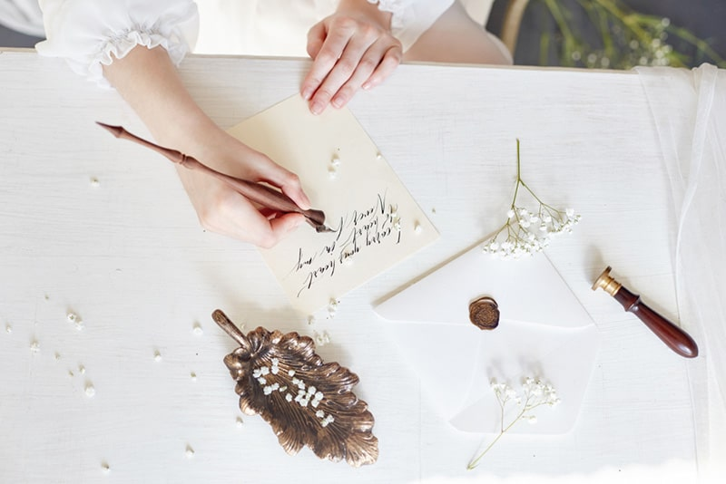 Woman write love letter on white table